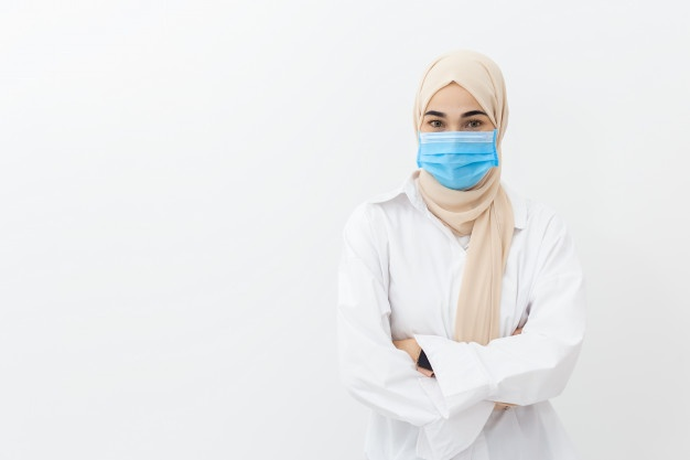 close-up-face-muslim-woman-wearing-medical-mask-for-prevent-infection-virus-on-white-wall-coronavirus-covid-19-concept_44868-782